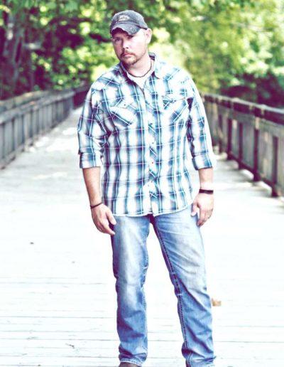 Country artist Jamie Brabham on bridge